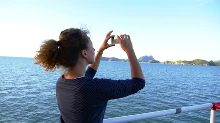 фотосъемка : Slow Motion of Woman Taking Photograph with a Smart Phone Camera of Picturesque Seascape from the Ferry. Nautical Cruise.