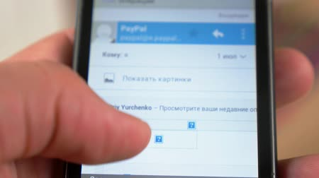 payment : Close up of Man Using Smart Phone and Checking Pay Pal Financial Account.  Stock Footage