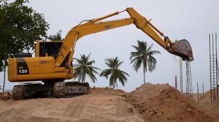 site : Excavator in Action on Construction Site. Speed up. HD, 1920x1080