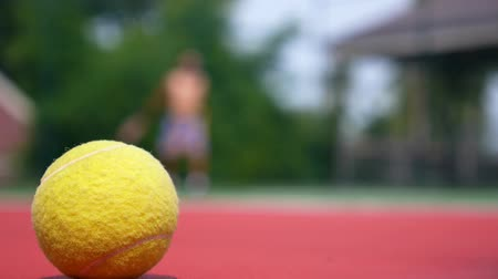 tennis game : Tennis player in action on tennis court (selective focus, focus on ball in the foreground) HD, 1920x1080. Stock Footage