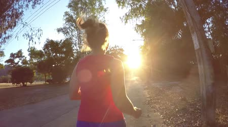 jogging : Fitness Female Training and Jogging Outside against Sunset. Sport Lifestyle. Slow Motion. HD, 1920x1080.