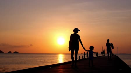 vacation destination : Family Walking at Sunset on the Pier on Vacation in Thailand, Koh Samui. HD, 1920x1080.