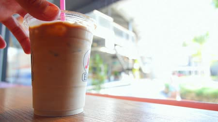 gelado : Male Hand Stirring Iced Coffee in Cafe. Closeup. HD, 1920x1080.