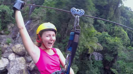 aventura : Extreme Woman Flying on Zip Line Adventure in Jungle. HD, 1920x1080.