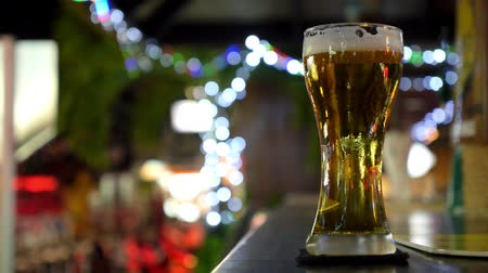 beer tap : Glass of Light Beer on Bar Counter in Pub. Closeup. HD, 1920x1080. Stock Footage