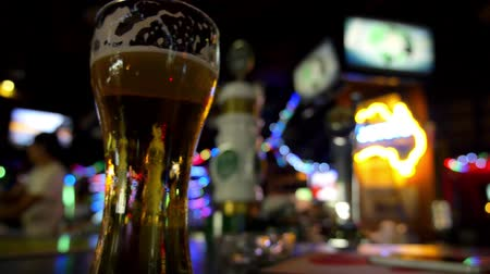 bögre : Close up Glass of Beer in Night Bar with Colorful Lighting. HD, 1920x1080.