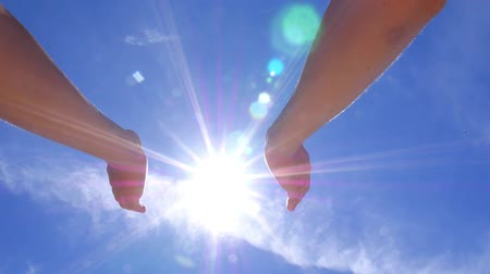 nimet : Female Hands Holding the Sun in Blue Sky. HD, 1920x1080. Stok Video