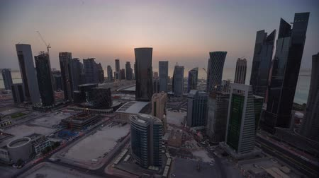 Doha skyline timelapse video day to night lights skycreapers downtown Qatar, Middle East Stockvideo