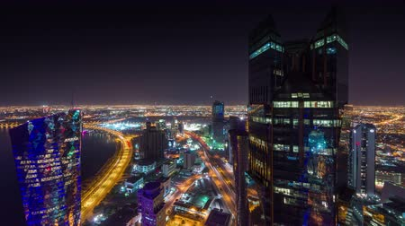 arabian peninsula : Doha timelapse video night lights skycreapers downtown Qatar, Middle East