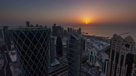 arabian : Doha skyline timelapse video day to night lights skycreapers downtown Qatar, Middle East Stock Footage