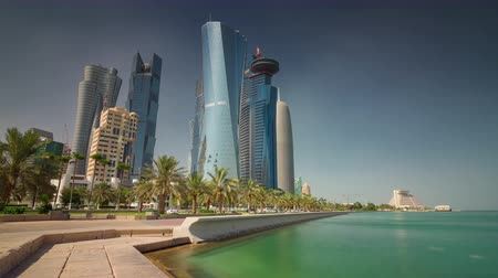 Doha skyline downtown skycreapers timelapse video waterfront corniche Qatar, Middle East Стоковые видеозаписи