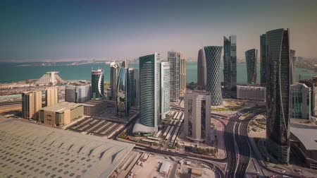 perzisch : Doha skyline downtown skycreapers timelapse video from rooftop Qatar, Middle East