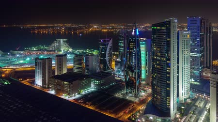 perzsa : Doha skyline timelapse video night lights skycreapers downtown Qatar, Middle East
