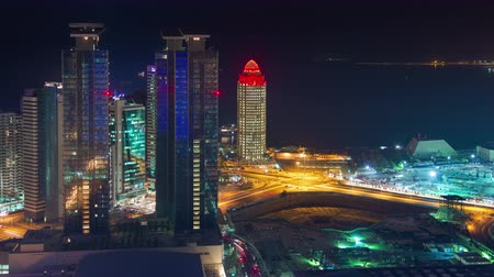 DOHA, QATAR - JUNE 30th 2017: skyline timelapse video night lights skycreapers downtown, Middle East
