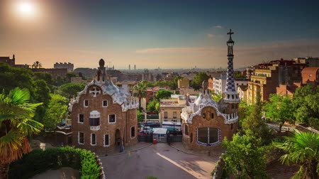каталонский : BARCELONA, CATALONIA - JULY 26th 2017: Timelapse Park Guel Gaudi architecture from above sunny day