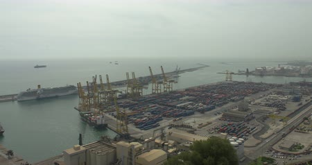 BARCELONA, SPAIN - JULY 15th 2017: Large cargo port in Barcelona. Cranes and containers. Aerial view