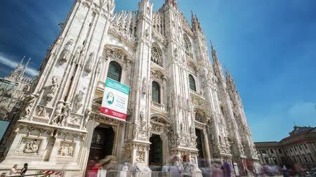 garibaldi : MILANO, ITALY - MAY 3, 2017: Duomo cathedral timelapse. Front view on square. Gothic architecture.