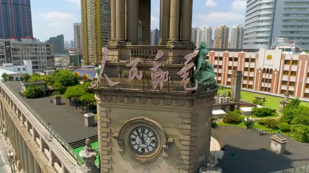 engedmény : SHANGHAI, CHINA - JULY 2016: Aerial drone view of shanghai post office tower with clocks, sculpture