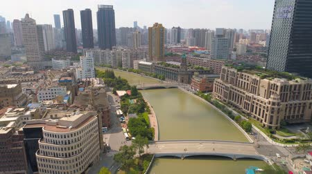 上海 : SHANGHAI, CHINA - MAY 5, 2017: Aerial view video, business skycreapers skyline Huangpu river bridge 動画素材