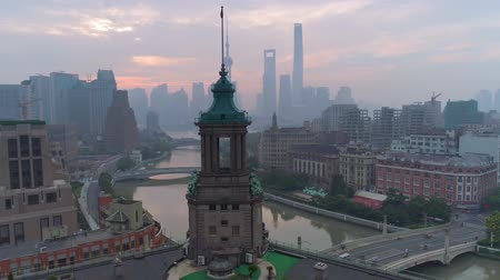 engedmény : Aerial drone view of shanghai post office tower with clocks, sculpture Stock mozgókép