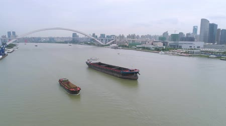 Aerial drone view of cargo vessels sailing over the Huangpu river Стоковые видеозаписи