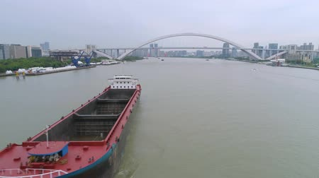 huangpu river : Aerial drone view of cargo vessels sailing over the Huangpu river Stock Footage