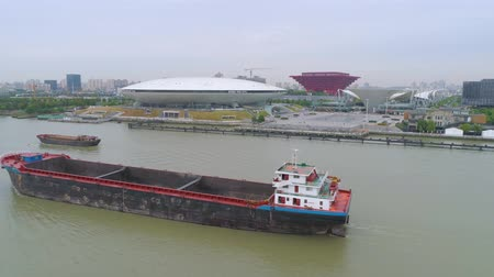 engedmény : SHANGHAI, CHINA - MAY 7, 2017: Aerial drone view of cargo vessels sailing over the Huangpu river