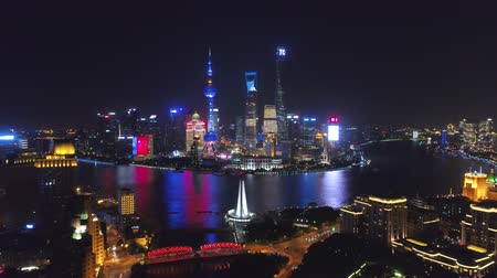 ekstra : SHANGHAI, CHINA - MAY 5, 2017 Aerial drone video, night time illuminated famous pudong cityscape
