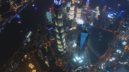 huangpu river : SHANGHAI, CHINA - MAY 5, 2017 Aerial drone video, night time illuminated famous pudong cityscape