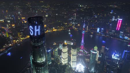 oryantal : SHANGHAI, CHINA - MAY 5, 2017 Aerial drone video, night time illuminated famous pudong cityscape
