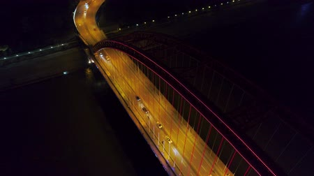dark bay : night time illuminated cityscape qingchuan bridge aerial drone