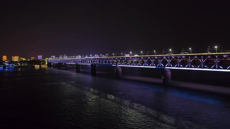 banco di pesci : night time illuminated cityscape qingchuan bridge aerial drone