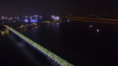 yangtze : night time illuminated cityscape qingchuan bridge aerial drone