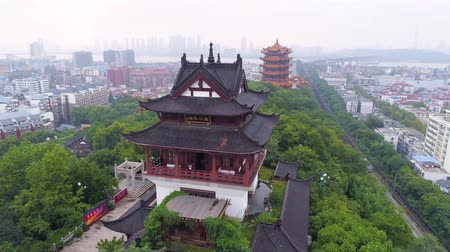 yangtze : WUHAN, CHINA - MAY 2, 2017: red gate bell temple park day yellow crane aerial drone view panorama