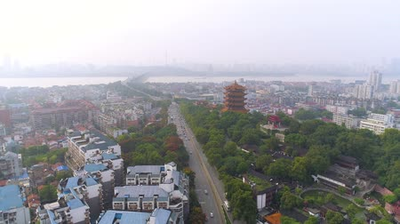 telhado : WUHAN, CHINA - MAY 2, 2017: red gate bell temple park day yellow crane aerial drone view panorama