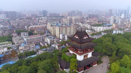 torre sineira : WUHAN, CHINA - MAY 2, 2017: red gate bell temple park day yellow crane aerial drone view panorama