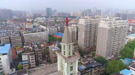povstání : WUHAN, CHINA - MAY 2, 2017: aerial drone view of the church buildings around in the city centre day