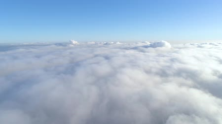 brisa : Winter drone shot above the clouds of the Minsk city snow sunny day residential buildings aerial