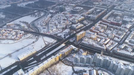 bělorusko : Winter drone shot of the Minsk city snow sunny day residential buildings from above aerial Dostupné videozáznamy