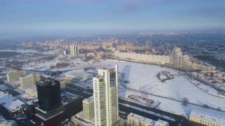 brisé : Winter drone shot of the Minsk city snow sunny day residential buildings from above aerial Vidéos Libres De Droits