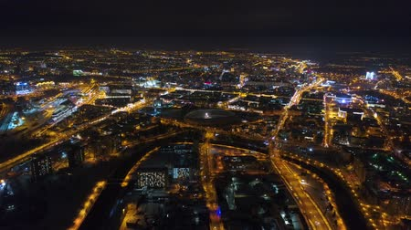 brisé : Winter drone shot Minsk city in the night residential and business buildings from above aerial Vidéos Libres De Droits