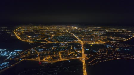 cars traffic : Winter drone shot Minsk city in the night residential and business buildings from above aerial Stock Footage