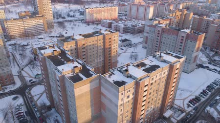 пригород : Winter drone shot of the Minsk city suburbs snow sunset residential buildings from above aerial