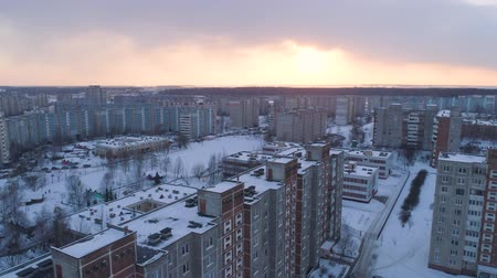 arrabaldes : Winter drone shot of the Minsk city suburbs snow sunset residential buildings from above aerial