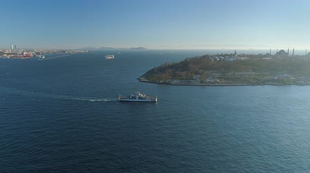 asma : Ships floating Bosphorus blue water sunny day. Aerial drone view on sunset in Istanbul, Turkey