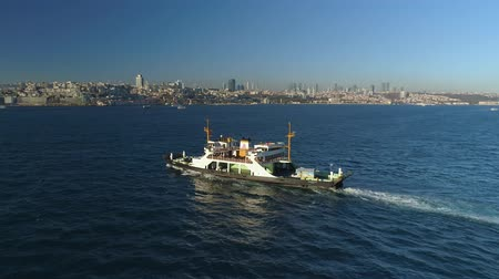 navette : Ships floating Bosphorus blue water sunny day. Aerial drone view on sunset in Istanbul, Turkey