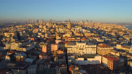 chifre : Galata tower in Istanbul, Turkie. Aerial drone shot from above, city centre, downtown. Sunset.