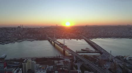 cami : Aerial drone view of the Istanbul, Turkie. Bosphorus Halic bay. Sunset. Fly over the bridges. Stok Video