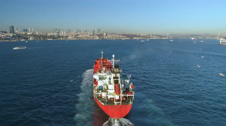 isztambul : ISTANBUL, TURKEY - 6 DEC,2017: Ship floating Bosphorus blue water sunny day. Aerial drone view on sunset.