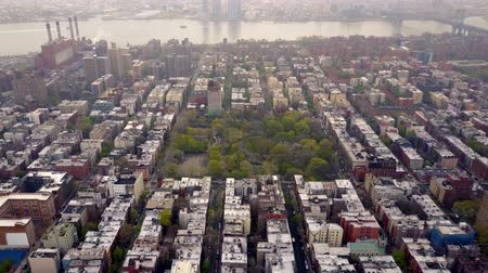 city park : Aerial view of New York, Midtown Manhattan. Residental buildings, streets ans crossroads from above.
